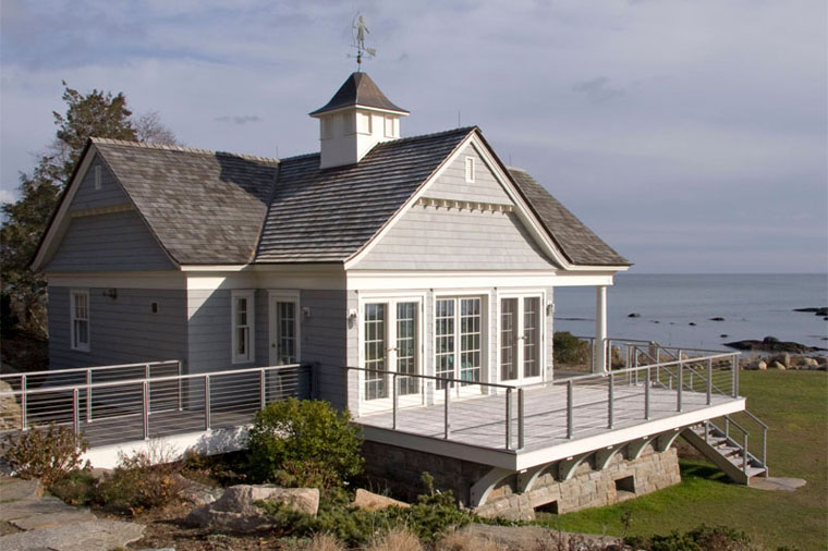 Shingle style waterfront guest house and boathouse in Guilford CT designed by Felhandler Steeneken Architects
